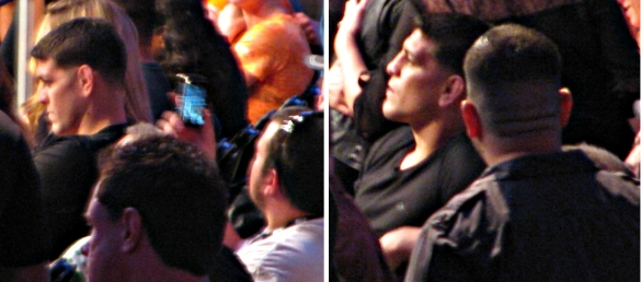 Nick Diaz watching Condit Woodley as a fan snaps a shot.